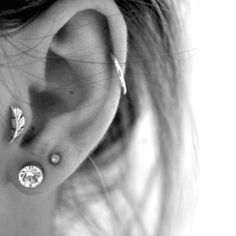 Love the feather piercing for the tragus and the cartilage hoop!
