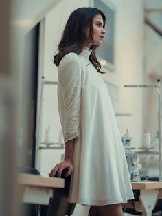 Laure de Sagazan Spring 2019 short shift wedding dress with three-quarter sleeves, high collar and puffed sleeves
