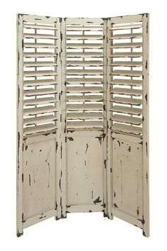 Farmhouse finish shutter door Room screen.  Cool.. I have a special love for chippy shutters!! :)