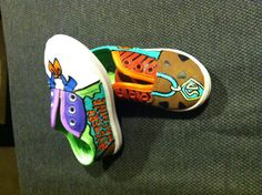 Use acrylic paint on canvas or fabric shoes to make hard to find character designs. Spray on a clear sealant when finished and it wont wear out. These are Scooby Doo I did for my little girl. Total cost was $3.00 for the shoes plus sealant cost and I already had the paint. What a great birthday present!