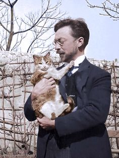 painters-in-color: Colorized photo of Wassily Kandinsky (1866-1944) and his cat Vaske, c.1906.