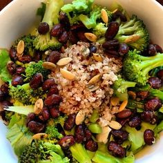 Quinoa salad with black beans, raw sprouted pumpkin seeds, broccoli, and cabbage