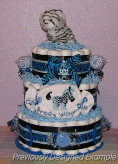 Adorable blue zebra baby boy diaper cake - Would make a sweet gift for a baby shower! For more zebra print baby shower ideas for a little boy, see http://www.squidoo.com/zebra-boy-baby-shower