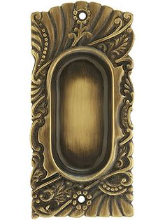 "Purists will delight in this faithful reproduction of P & F Corbin's lively and charming ""Roanoke"" pattern pocket door pull. The circa 1900 design works well with everything from Queen Anne to Craftsman, from restorations to new construction.  Cast in solid brass, this pull comes in our own Antique-By-Hand finish. This hand-applied process produces a living finish that continues to age gracefully for many years to come"