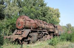 An abandoned train left to rust. Shameful! Looks as though it was a beauty in it's time.