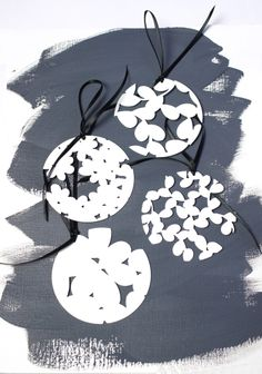 Laser cut ornament. Powder coated in white. Perfect for holiday decorating or gift giving by Megan Auman