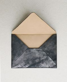 coal black envelope with silver dusting