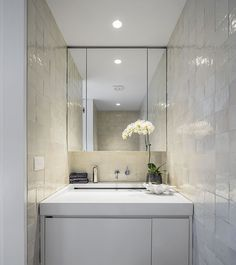 McNally Architects, Balmoral House | Powder room and Laundry with washing machine located under the custom made basin. The hand glazed tiles and luxury finishes disguise the other uses of this room @mcnallyarchitects