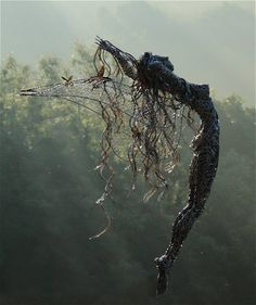 Butterflies - stainless steel Fairy arching back holding her hair which is full of butterflies. By Fantasywire.