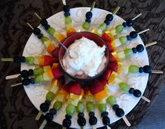 football fruit colors: blackberries and strawberries, blueberries and oranges or cantaloupe, strawberries and pineapple, etc etc.