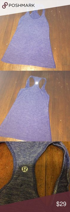 Lululemon blue tank No size that I can fine. Nice condition. I would say it's a small to medium. lululemon athletica Tops Tank Tops