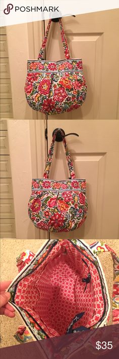 NWOT Vera Bradley Bag Perfect Condition, no flaws! Never been used. several pockets: 2 on the exterior and 3 on the interior also 1 zip up pocket inside as well. Super Cute! Vera Bradley Bags Shoulder Bags
