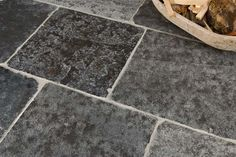 This is a wonderful dark black toned flagstone that is hand-aged to form a historic, worn-in look. With incidences of fools gold, the aged appearance of this lustrous limestone creates a floor of depth and soul. Flagstone Flooring, Limestone Flooring, Natural Stone Flooring, Grey Flooring, Engineered Oak Flooring, Concrete Pad, Flooring Options, Flooring Ideas, Black Tiles