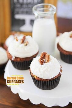 Carrot Cake Cupcakes loaded with pineapple, coconut and pecans and topped with pineapple cream cheese frosting! by camille