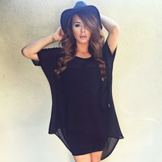 Mariah Longo brought the vavavoom with a sheer layer over the black Major Mini Dress. #LBD