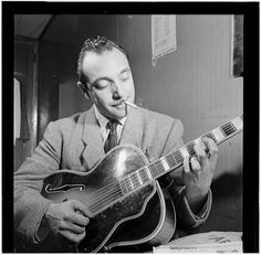 Famous photo of one of my favorite guitarist, Django Reinhardt, taken by William Gotlieb in NY city c1946. Note Djangos' crippled left hand - burned in a fire in the early 1920's. With that accident, Reinhardt developed a whole new way of playing jazz using triads.