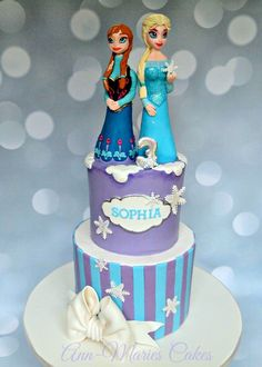 Frozen Birthday with Elsa and Anna - Frozen Themed Birthday. White Velvet cake, Strawberry filling, White Chocolate Ganache. Gumpaste Anna and Elsa Figures. By Ann-Maries Cakes