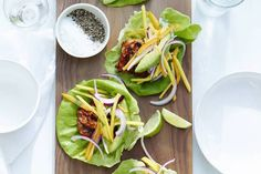 Chipotle Chicken Lettuce Wraps are the perfect healthy bite with spicy chipotle chicken and a mango pepper slaw on top!