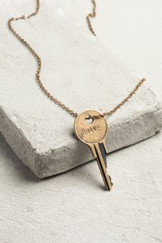 Turn an old key into a classic necklace with a little engraving.  Love this idea.  Must do it with our first house key.