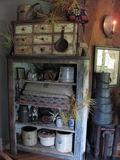Prim Needfuls...old coverlets & crocks...chippy cupboard with drawers.
