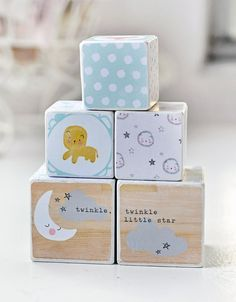 Here is a really adorable set of 5 wood blocks. Two measure 2 and 1/2 inches and three are 2 inches each. Each block has been distressed and painted white, and features cute trendy designs. You will find stars, moons, happy clouds and cute creatures including lions, foxes and bears. Each block has been sealed with a protective, non-toxic varnish.  *Please note that although these blocks have been constructed with non-toxic materials, they are not intended to be used as a toy and are stri...