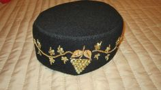 Vintage ladies pillbox hat with gold bead  grape vine  embellishment.