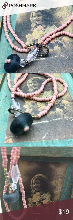 """A simple cute beaded necklace If you're one of those who like simplicity, this one is effortless. Antique pink beaded necklace. The closure is at the front made of a beautiful grey recycled see glass that goes Into the loop. Clear beads also enhances the colors at the front. It's o e of my older days pieces that meets the front stage once again. 18"""" long. One of a kind. I may have worn it but it's in a like new condition. Matana Jewelry Necklaces"""