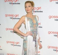 Blake Lively looks absolutely gorgeous in this silver detail and white draped tassel dress