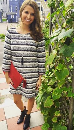 New Fall Mystree black and white striped dress with Donna Dressler tassel necklace and red faux suede clutch