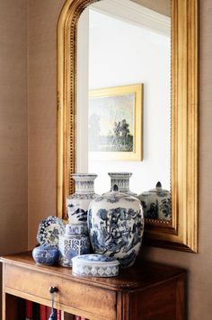 Beautiful hall display,  collection of blue and white, and a gold mirror