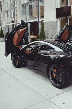 gorgeous black mclaren mp4-12c w/ a hint of chocolate brown interior