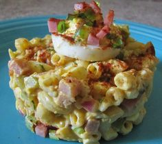 Deviled Egg Macaroni Pasta Salad Recipe Salads with elbow macaroni, eggs, honey glazed ham, purple onion, celery, sweet pickle, mayonnaise, yellow mustard, ground white pepper, old bay seasoning, paprika, fresh dill, sweet pickle juice, green onions, honey glazed ham, paprika