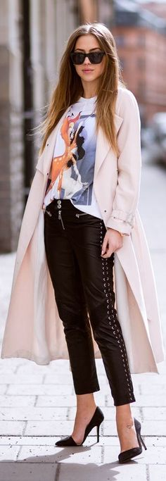 Black stylish leather pants and long pink trench.