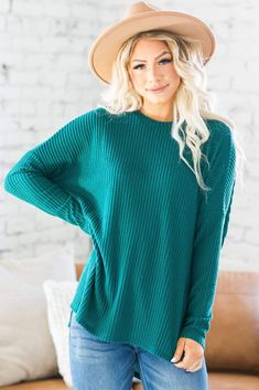 Swoon! We can't get enough of our Sloane Crew Neck Waffle Sweater! Simple, yet sophisticated this sweater features long sleeves a gorgeous waffle texture, and split hem. Dress it up with your favorite pencil skirt or rock it casually with a pair of jeans, either way, you're sure to look and feel great!