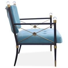 This year, my Jackie is in China. Jewel tones, black lacquer, shiny brass, crisp Greek key trim, and Chinoiserie details are decorating necessities. Jonathan Adler Rider Lounge Chair
