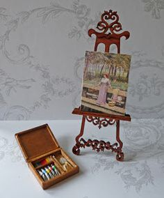 All about dollhouses and miniatures: Artist paint box, easel and painting, all in miniature.  Love love love...