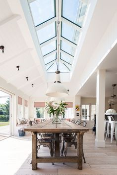 Randell Design Group completely renovated a 1960's home into a large New England style home in Sidlesham, West Sussex.