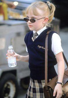 Little girl Dakota Fanning with her school bag holding a bottle of water.