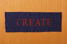 Cut a word from wool and fuse it to a contrasting piece of wool, then stitch around the letters.