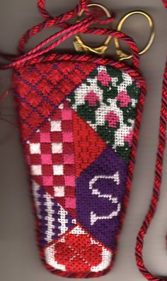Roses Are Red Scissors Case from Whimsy & grace. Stitch guide available from Napa Needlepoint. Guide copyright Napa Needlepoint.