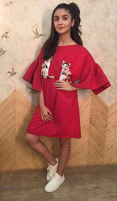 Alia Bhatt wearing a cute red dress with bell sleeves by Pink Porcupine.