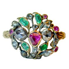 Georgian Giardinetti or little garden ring is set with diamonds, rubies and emeralds in 15K gold and silver. Giardinetti rings were first made in Italy in the late 17th century, designed as bouquets or pots of flowers. They are symbols of love and were given as love tokens. Circa 1750s