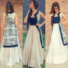 Off white lehenga with fabric border and with blue sartton sleeveless blouse and blue printe jacket