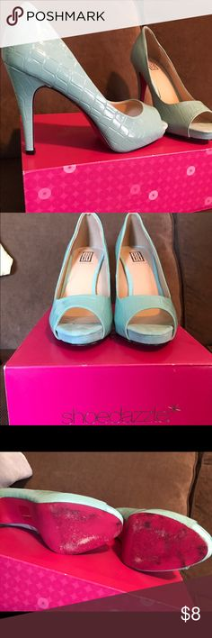 ShoeDazzle mint peep-toe heels These run a 1/2 size small!!! They are a 7 but fit as a 6 1/2. Super cute with a pink sole!!! Some wear on the ball of the foot. They look brand new otherwise. My foot shrunk and they don't fit anymore 😔 Shoe Dazzle Shoes Heels