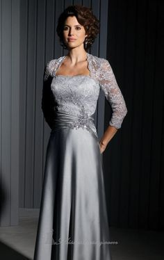 Lace sleeve mother of the groom dresses can be elegant for many occasions.  This formal gown was made in a platinum silver color. If you had our US dress design company produce a recreateion of this mother of the groom dress for you we could make it in any color, size or with any changes. Get more info on custom mother of the groom evening dresses at www.dariuscordell.com