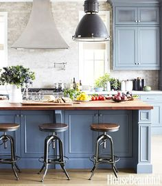Having a Moment: Blue-Gray Kitchen Cabinets // butcher block countertop, industrial pendant, wood and metal bar stool