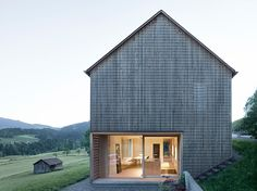 Grid-patterned façade by Innauer-Matt Architekten, photo Adolf Bereuter – http://www.woodarchitecture.se/stories/captivating-and-changing-family-house #architecture in #wood