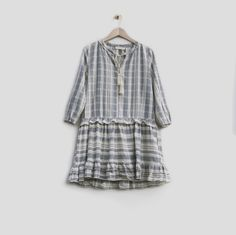 PRODUCT DETAILSJacquard stripe cotton dress with a layered ruffle hem and ...
