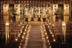 A stunning Montelucia wedding with lush petals and lanterns down the aisle with hanging votives and strings of orchids. Just beautiful #monteluciawedding #monteluciaceremony