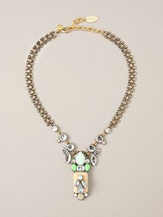 """Delilah Brass & Glass Cabachon Statement Necklace: This 16"""" necklace features sparkling, multi-colored glass cabochons and a pale pink and green vintage-inspired pendant on a brass chain. An 18-karat gold-plated brass lobster claw clasp and 7.5"""" extender finish the piece."""